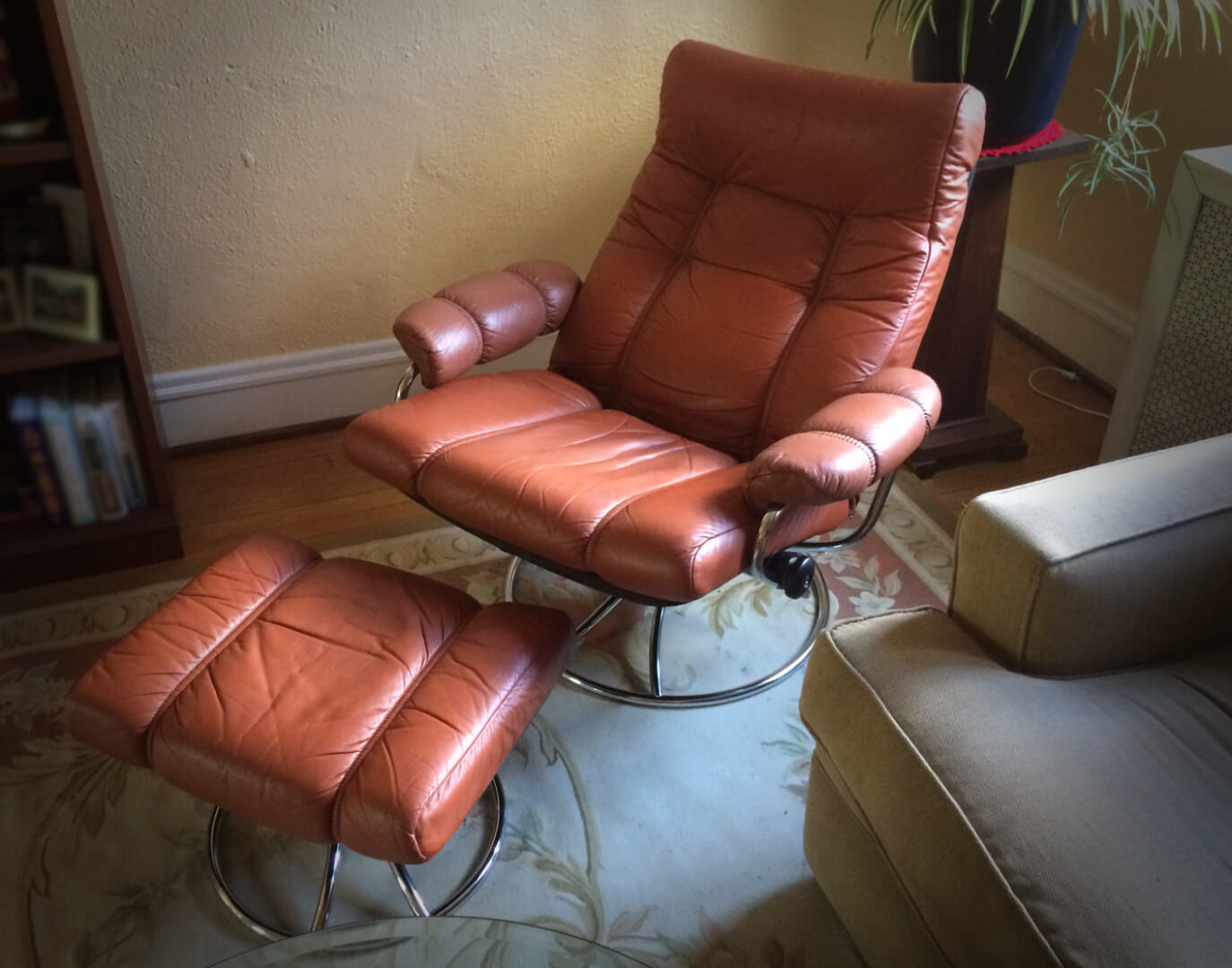 Our first Ekornes Stressless Lounge Chair - a 70s version in burnt orange! Love the chrome, it was worth spending more on.