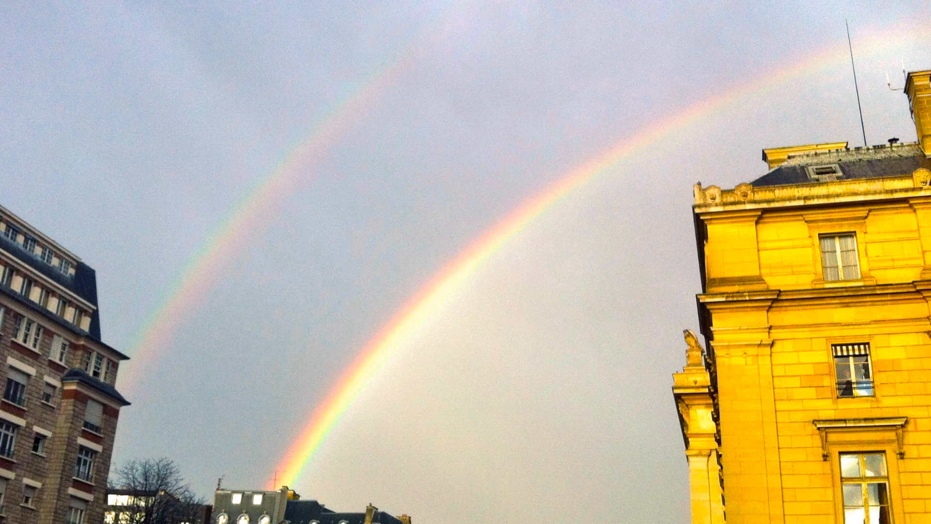 A rare double rainbow in Paris has to signify something positive, right?
