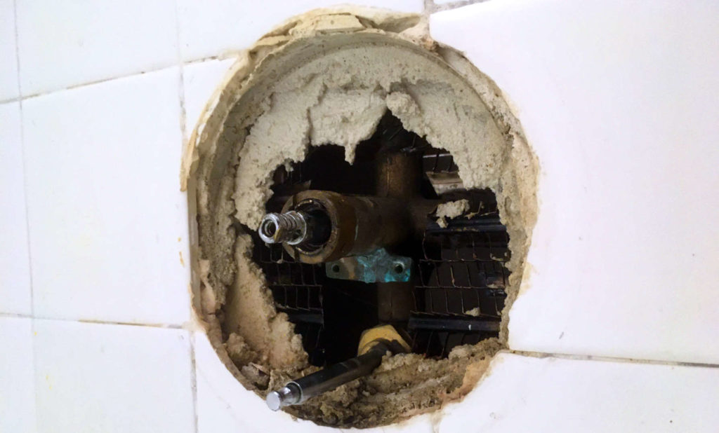Leaking bathroom shower faucet from valve.
