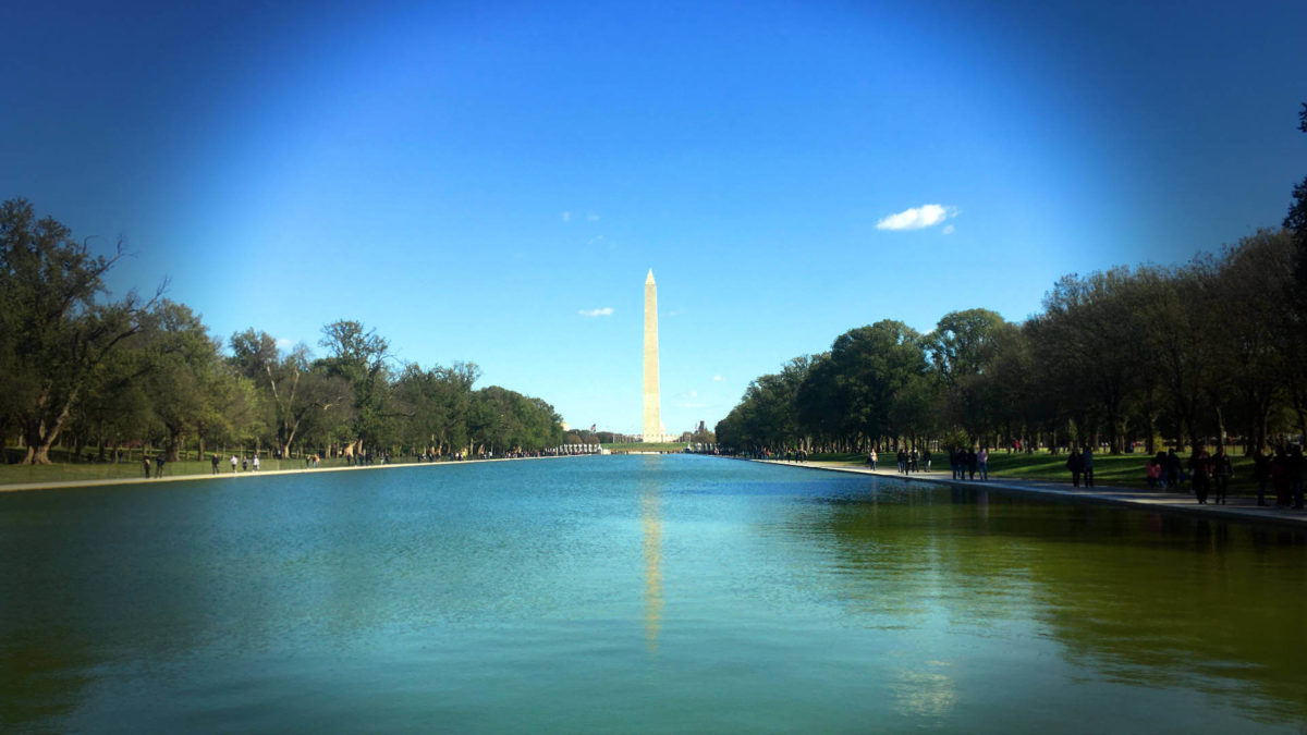DC city life vs country life: A shot of Washington DC's monument across the reflecting pool.