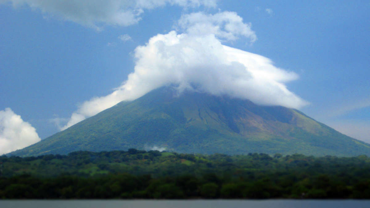 Don't let comparison be the thief of joy in your life. Comparisons are shrouded in haze not unlike the summit of financial independence. Photo: Concepción volcano in Nicaragua before our hike.