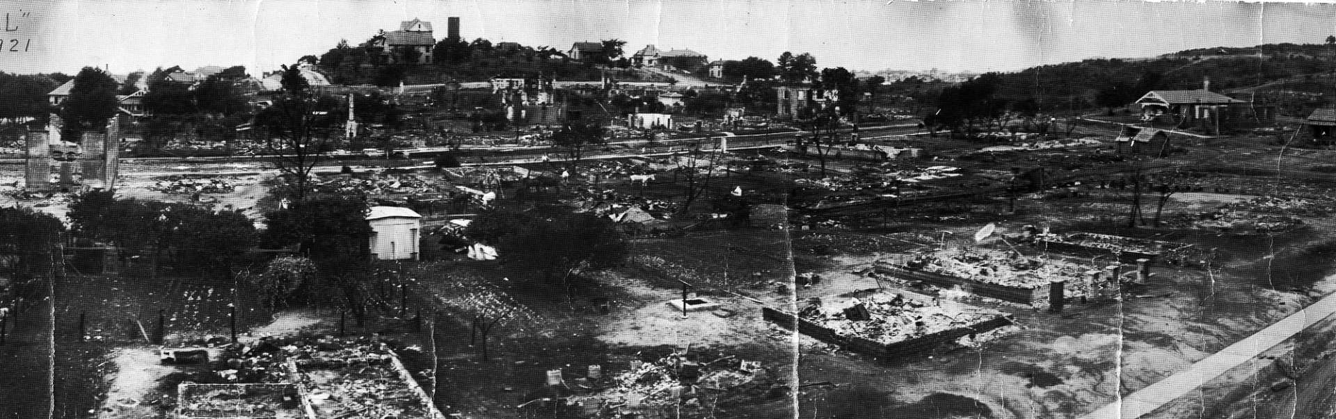 The destruction of Black Wall Street during the Tulsa Race Massacre, 1921. Image: Standpipe Hill destruction [source: OSU Digital Collections].