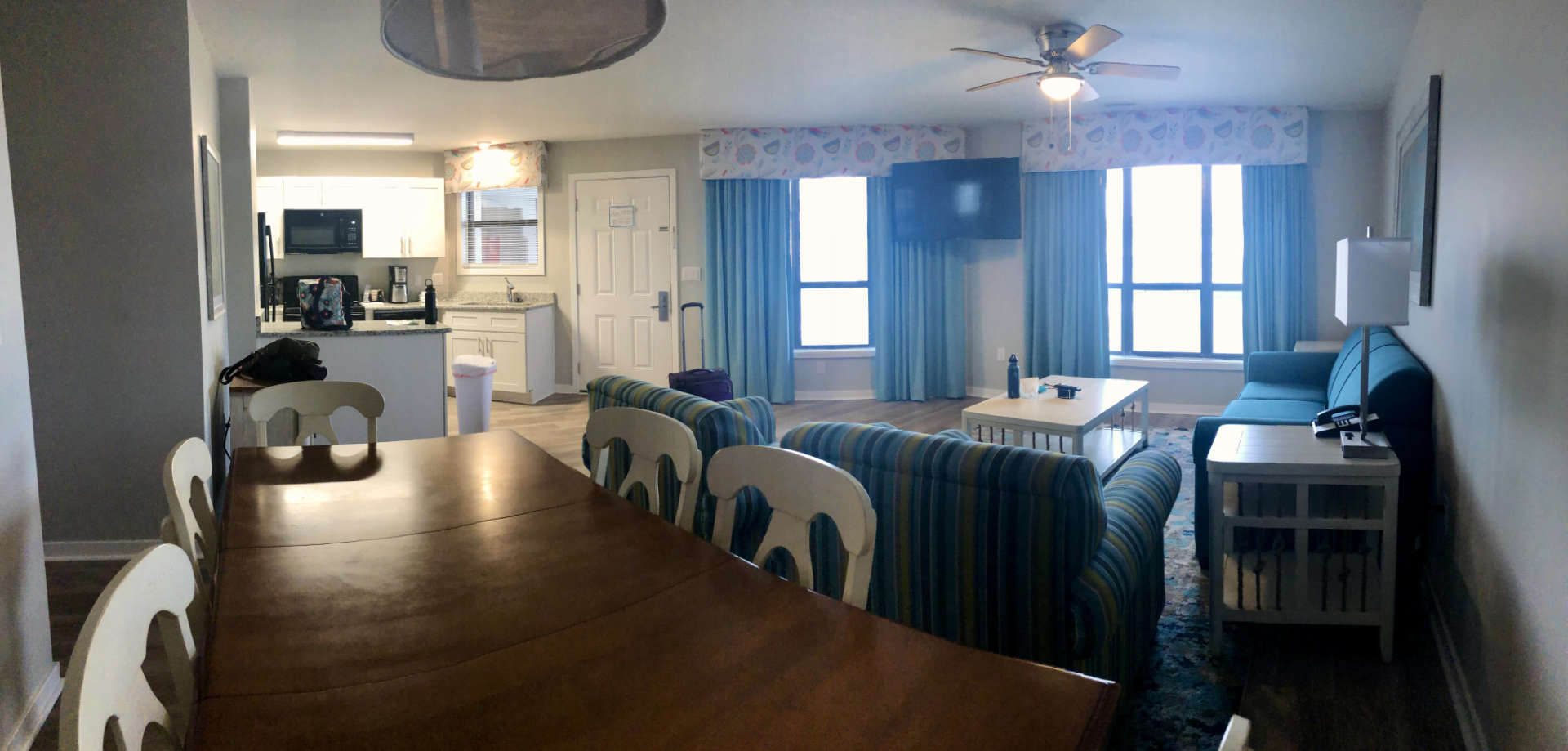 The dining room, living room, and kitchen setup in our beach condo.