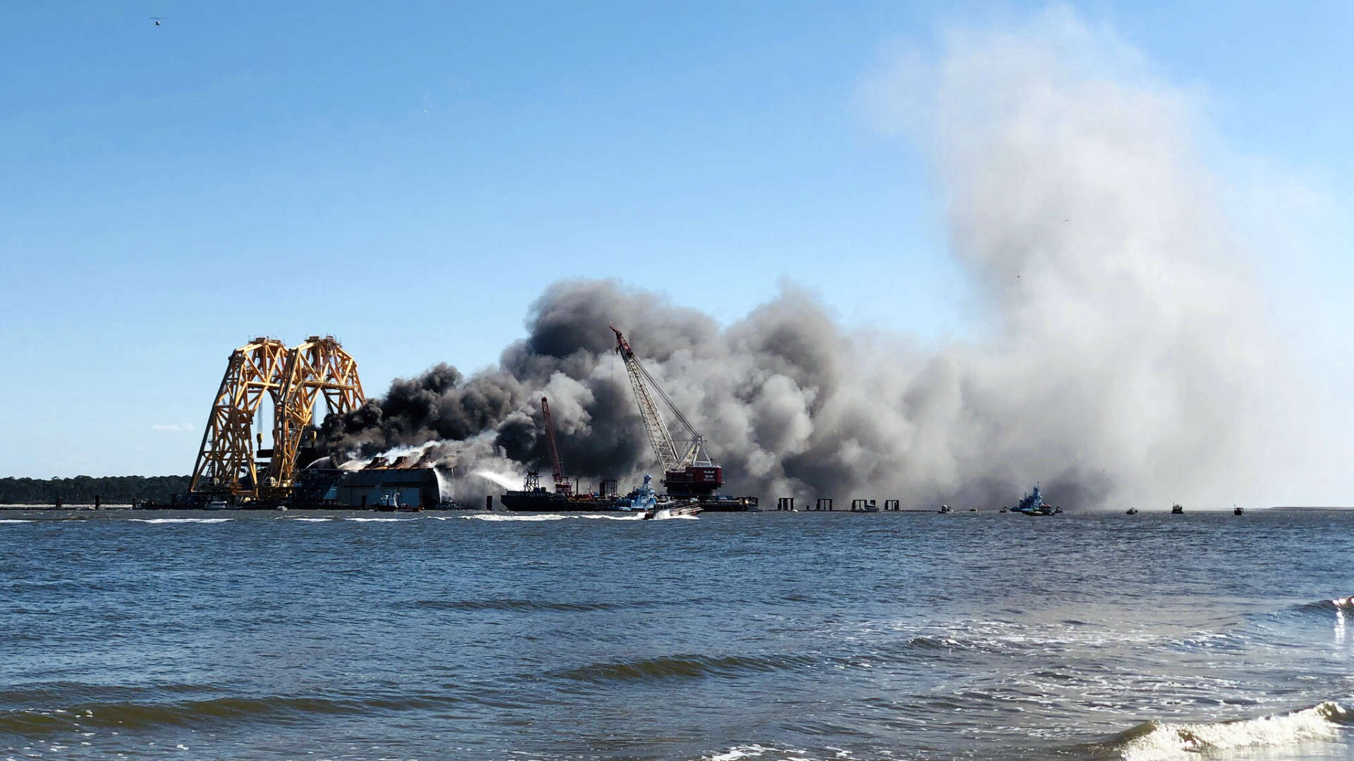 An overturned cargo ship, slowly being disassembled and removed the past two years, caught fire just off Saint Simons Island while we were visiting!