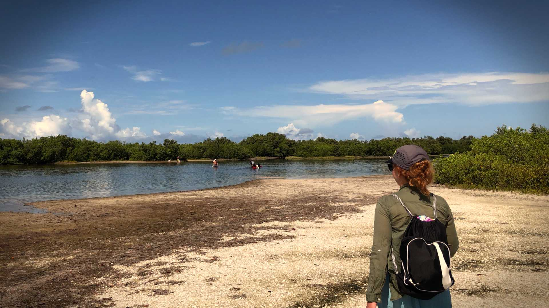 Tigertail Beach's lagoon, separating the wilder beach from the more accessible parts. Another family was coming back across toward us.